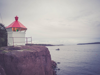 Vintage style: TONSBERG, NORWAY - October 9, 2013 Lighthouse in the fjord, Tonsberg, Norway