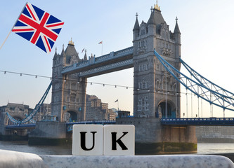 United Kingdom in the form of words with the help of cubes against the background of the Tower Bridge