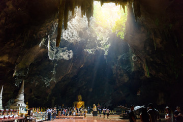 shaft of light - Light shines through the bottom of the cave : Khao Luang Cave