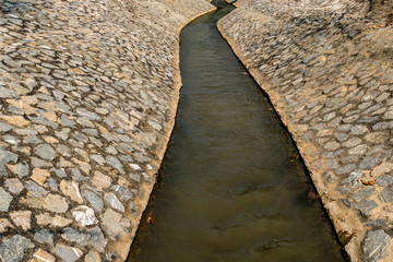 Irrigation canal with stone wall