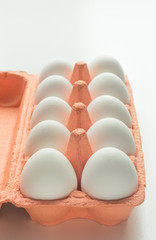 Carton of organic white eggs. Selective focus.