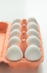 Carton of organic white eggs. Selective focus.