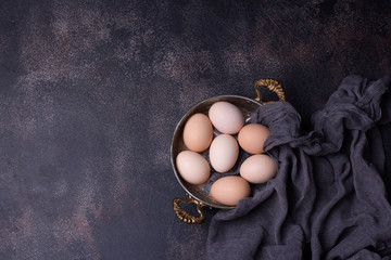 Raw Organic Brown Eggs in a copper bowl