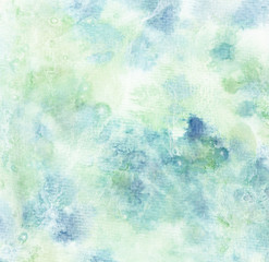Abstract hand painted watercolor background on textured paper in light blue shades