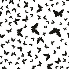 Symmetrical pattern of random butterflies black on white. Suitable for festive and celebratory decoration.