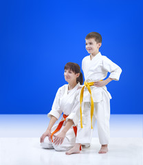 On light blue background mother and son the athletes