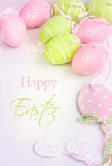 Easter pastel eggs on white background.
