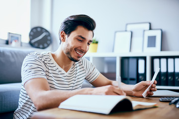 Man at home calculating home finances