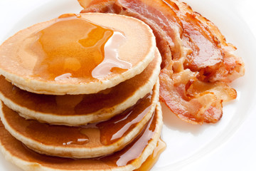 Pancakes with maple syrup and Bacon on a white background. Breakfast, snacks. Shrove Tuesday.