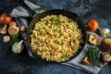 Mushroom Risotto in iron pan with herbs and parmesan cheese