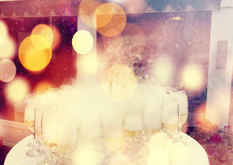 Carbonic ice champagne glasses party background