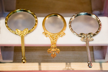 Little decorative gold color hand mirror