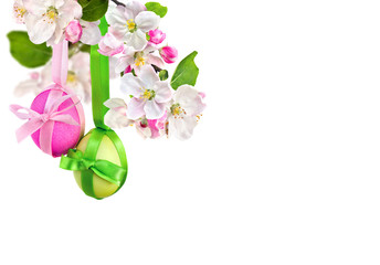 Beautiful Easter decoration. Apple blossom and Easter eggs on white background