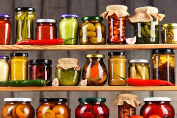 Jars with variety of pickled vegetables.