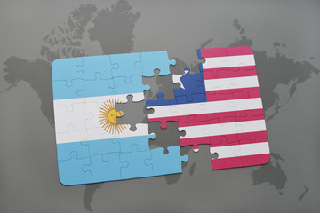 puzzle with the national flag of argentina and liberia on a world map