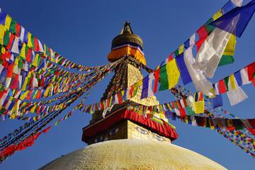 Top of the Boudhanath Stupa with prayer flags. Kathmandu valley, Nepal