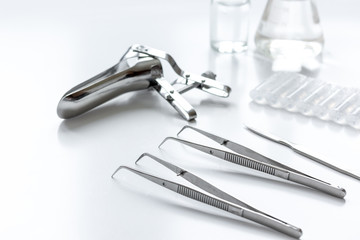 instruments of gynecologist on white background