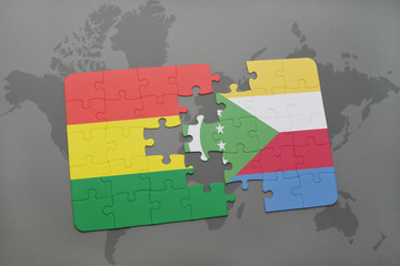 puzzle with the national flag of bolivia and comoros on a world map