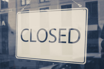 closed sign on shop entrance door
