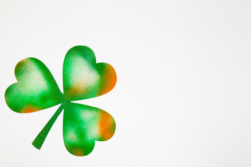 Spray pained on Irish lucky four-leaf clover isolated on white background