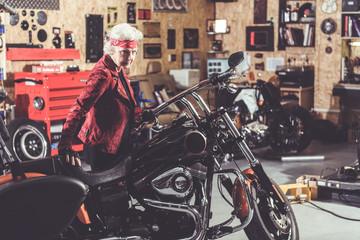 Serious retiree locating near bike in garage