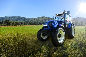Modern farm tractor Fototapete