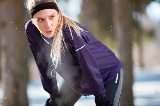 Girl make short break from running.