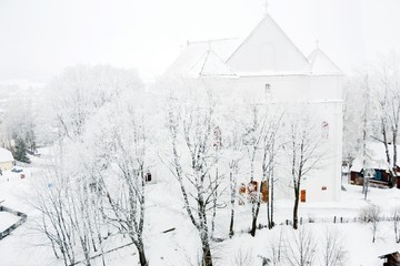 Church on a background of snow-covered tree in winter