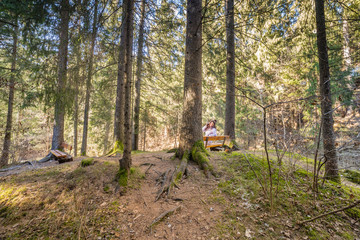 woman talking on mobile phone in forest