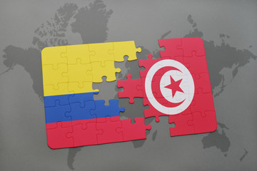 puzzle with the national flag of colombia and tunisia on a world map