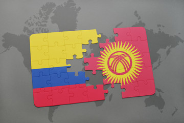 puzzle with the national flag of colombia and kyrgyzstan on a world map