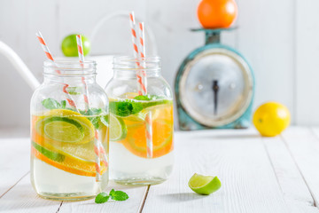 Healthy water with mint leaves and citrus fruits