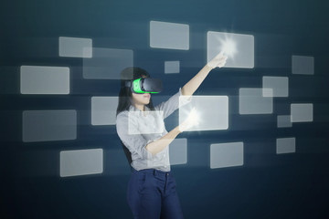 Woman with futuristic screen and VR headset