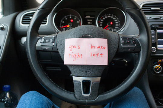 sheets of paper with a reminder where the gas, and where to brake the car