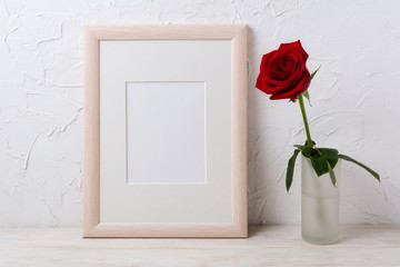 Wooden frame mockup with red rose in glass vase