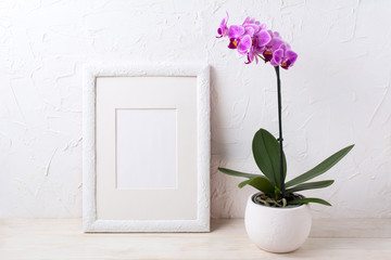 White frame mockup with purple orchid in flower pot