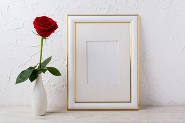 Frame mockup with red rose in elegant vase