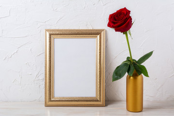 Gold frame mockup with dark red rose in vase