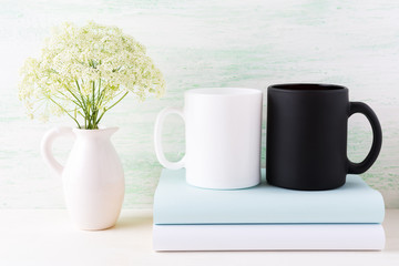 White and black mug mockup with books and white flowers