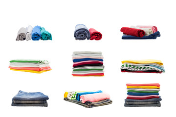stacks of colorful clothing collection isolated on white background.