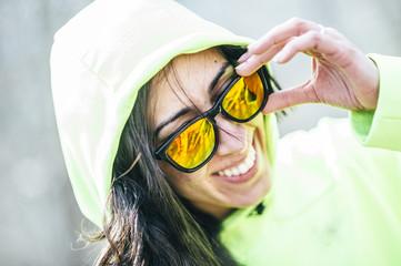 Fashion portrait of young woman wearing black sunglasses.