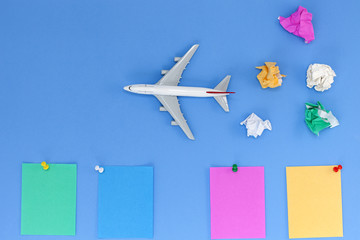 Airplane model with colorful blank paper note on blue background, picture for add text message or used background, website, travel and tour background.