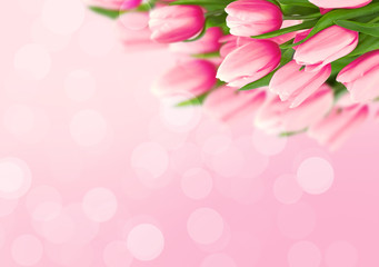 Bouquet of tulips on pink background with space for message. Valentine's Day and Mother's Day background. Toned image. Soft focus.