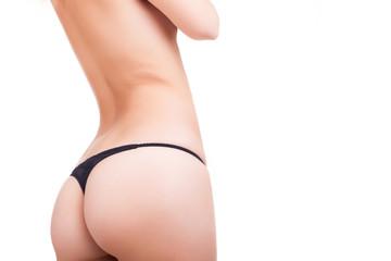 Sexy but in black bikini over white background
