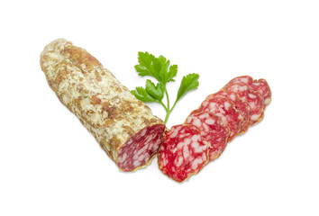 Salami and twig of parsley on a light background