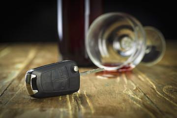 Car keys against a glass with alcohol
