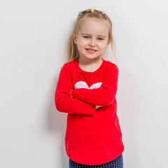 cute laughing girl in red sweater