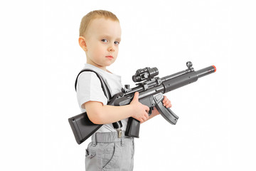 Boy with toy machine gun on a white background.