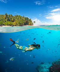 Young woman snorkeling on tropical beach