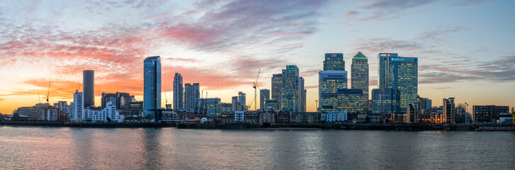 Panorama of Isle of Dogs and Canary Wharf in London at sunset